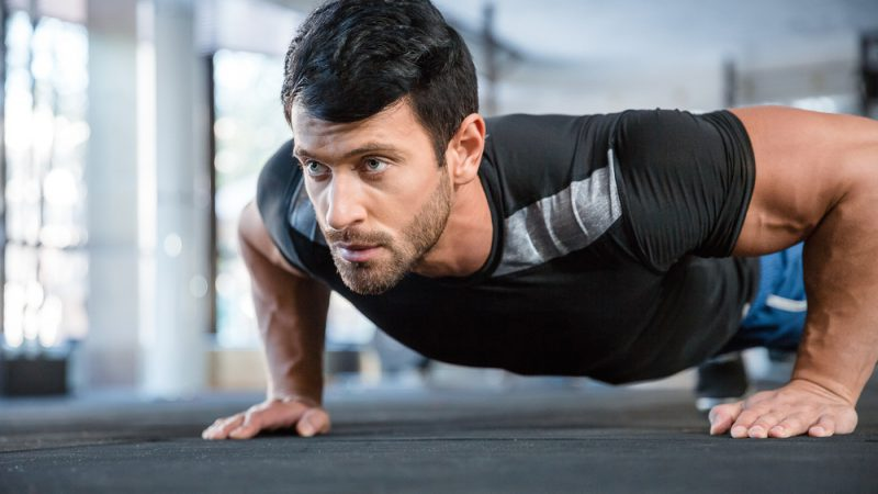 Trident Anti Aging client doing push ups in the gym.
